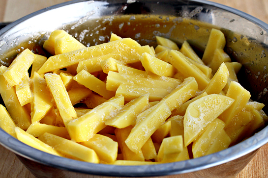 man-approved-spicy-oven-baked-french-fries-recipe-with-step-by-step-photos-dip-the-cut-potatoes-in-egg-to-coat