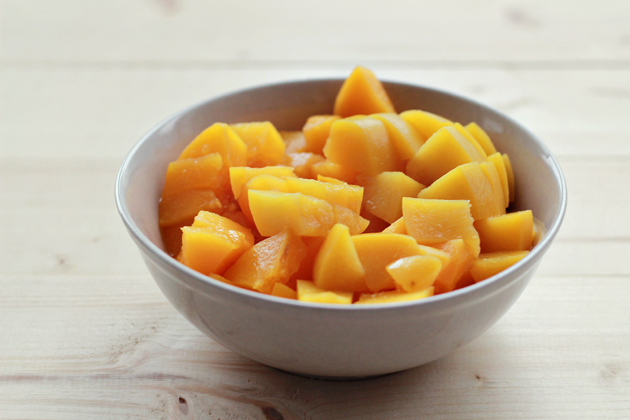 diced peaches in a bowl for peach muffins
