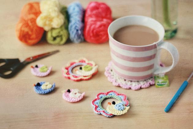 little crochet birdies and their colorful crochet wreaths