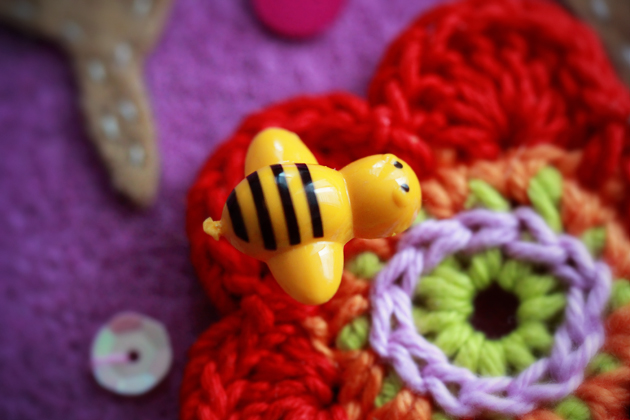 bee pin on a crochet flower
