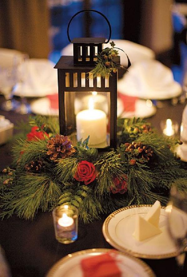 winter-wedding-flowers-wedding-centerpiece-of-lanterns-pine-boughs-roses-and-pinecones