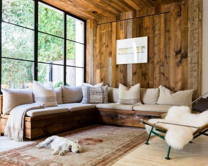 Vintage Inspired Wooden Pallet Corner Sofa With White Cushions And Pillows