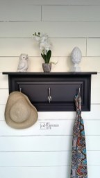 Old Cabinet Door Repurposed As A Small Black Rack Shelf