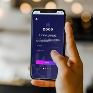 An app user is inputting information on ZOOO app.