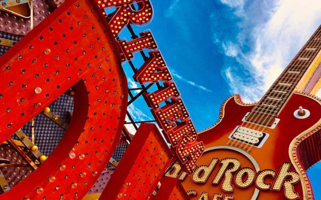 The neon red signs from the Riviera and Hard Rock Hotel rest at the Neon Boneyard Museum in Las Vegas.