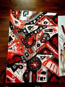 Abstrakt v červenočernobílé, plno geometrických tvarů s detaily.