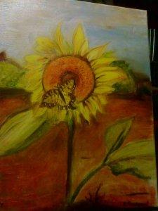 Obraz slunečnice a motýla na plátně malovaný temperovými barvami.