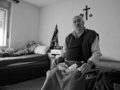 How to survive? Ivica and his wife were living off 100 euros a month when I met them. All of the medication in his lap is his daily dosage. (2012)