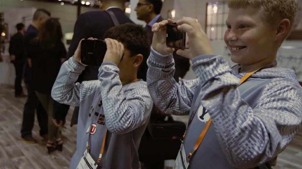 Zubr event kids trying augmented mixed reality cube experience