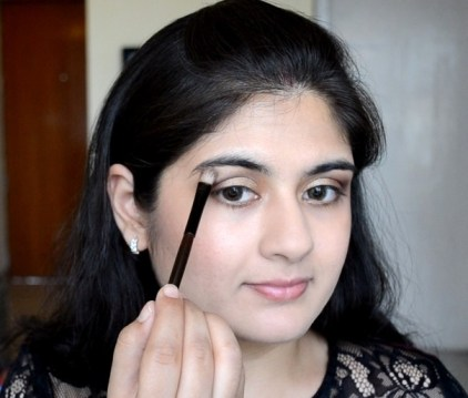 How to apply makeup - Chic bronze and purple eye makeup 11