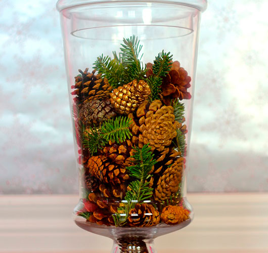 The photo shows - DIY Christmas decorations, fig. Cones in a vase