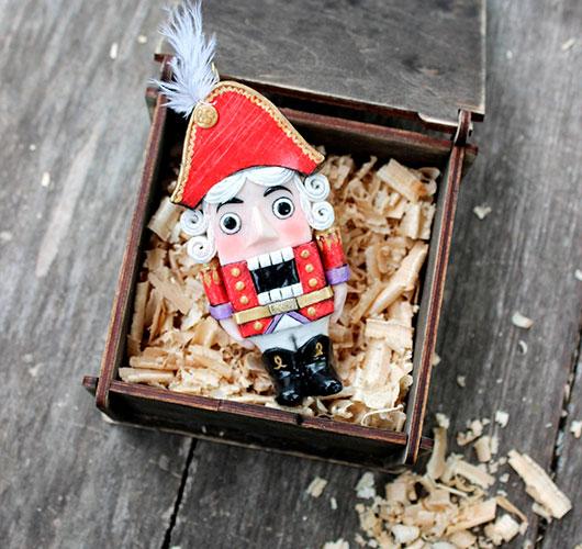 The photo shows - DIY Christmas decorations, fig. Plastic nutcracker