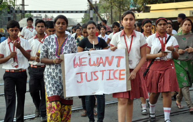 Students of Convent of Jesus and Mary School participate in a protest against the gang rape of a nun in her 70s by a group of bandits when she tried to prevent them from robbing the Christian missionary school in Begopara