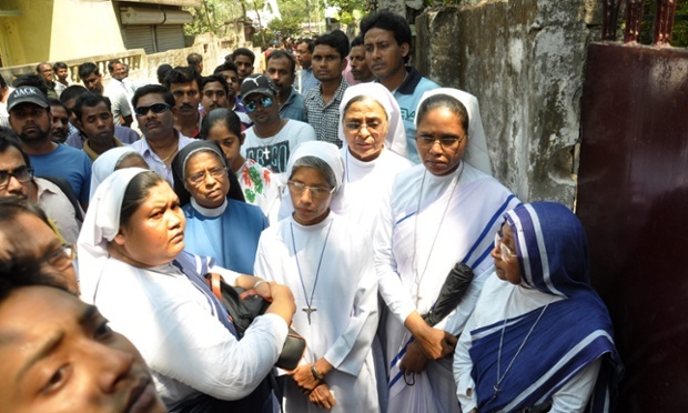 Nuns and other locals in front of a convent school at Ranaghat, where robbers raped an elderly nun