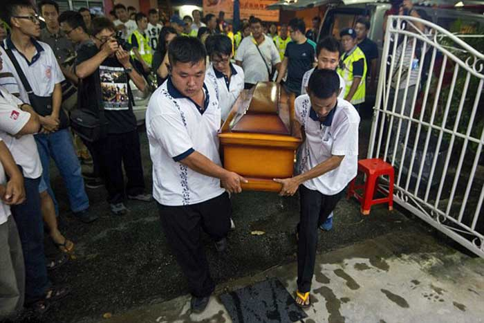 Life cut tragically short: Funeral workers carry the coffin of 4-year-old Lee Jing Xuan, who was killed in the Bangkok bomb blast, to her family house in Butterworth, Penang, 350km from Kuala Lumpur in Malaysia