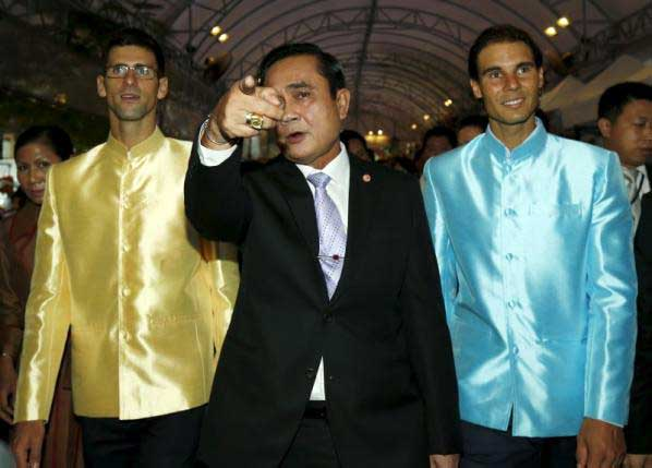 Prayut-shows-the-way-to-tennis-players-Novak-Djokovic--of-Serbia-and-Rafael-Nadal-of-Spain-as-they-visit-a-fair-outside-the-Government-House-in-Bangkok,-Thailand,-October-2,-2015