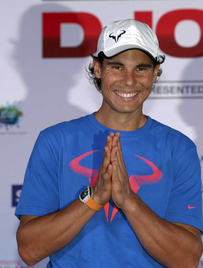 """Rafael Nadal of Spain poses for photographers after a news conference ahead of Friday's tennis friendly match against Novak Djokovic called """"Back To Thailand - Nadal vs Djokovic"""" at a hotel in Bangkok, Thailand, October 1, 2015. REUTERS/Chaiwat Subprasom"""