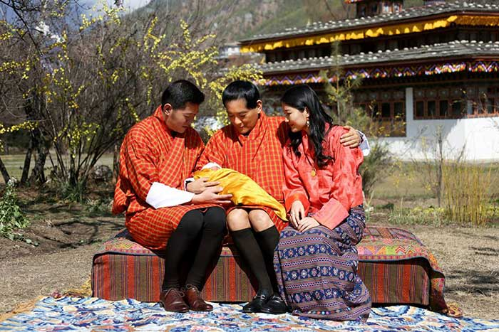 The King and Queen of #Bhutan show off their son in his 1st official photo, held by his grandfather, the former King