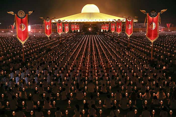 Thousands-of-believers-join-Buddhist-monks-praying-at-the-Wat-Phra-Dhammakaya-temple-in-Pathum-Thani-province