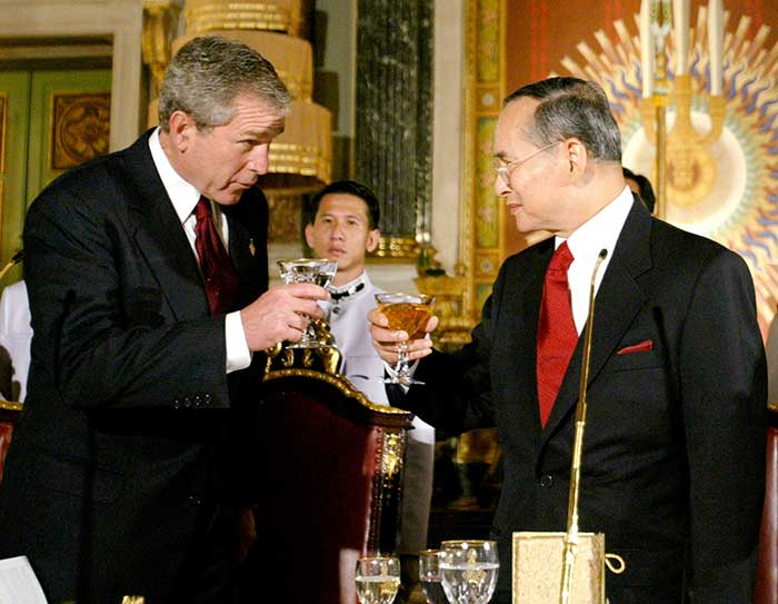 19 October 2003: US President George W Bush toasts with Thailand's King Bhumibol Adulyadej as they take part in a State Dinner at the Royal Grand Palace in Bangkok