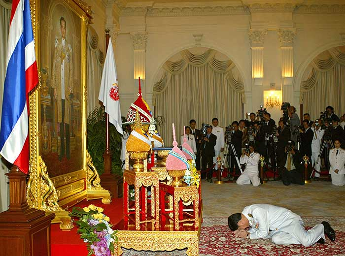 9 March 2005: Thai Prime Minister Thaksin Shinawatra prostrates himself before a picture of Thai King Bhumibol Adulyadej after receiving the royal command