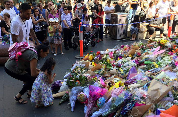 people-pay-their-respects-to-the-victims-of-the-chilling-attack-in-melbourne