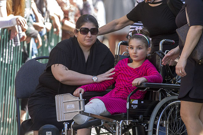 thalias-sister-maggie-arrives-at-a-memorial-at-beth-tivkah-ladies-college-on-wednesday-morning-her-mother-still-in-critical-condition-in-the-hospital