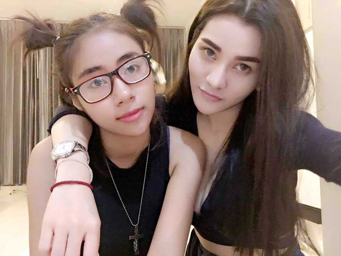 "Preeyanuch ""Preaw"" Nonwangchai, 24, suspected of strangling the victim to death and then sawing her body in half, is still at large while (left) alleged accomplice Jidarat ""Aom"" Promkhun, 21, has been detained."