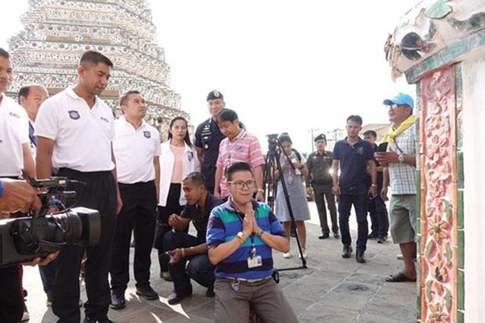 Noranontha Norakamin, 44, offers an apology at Wat Arun on Saturday