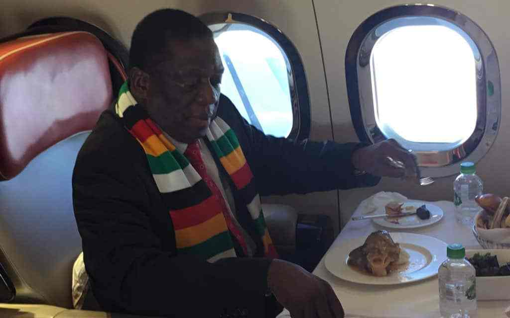 PICTURES:President Mnangagwa eating mazondo in plane