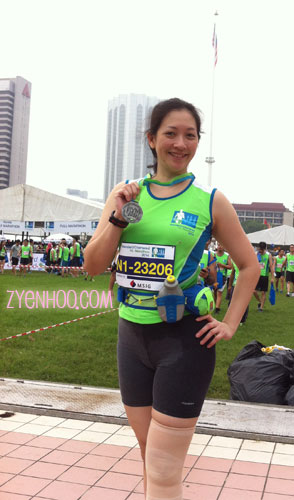 Me with my finisher medal! Ignore the trash bags please.