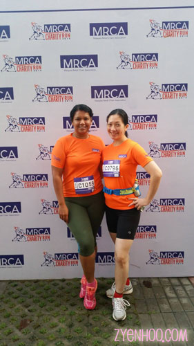 """Farah and I taking a """"before"""" shot at the photobooth area before the run"""