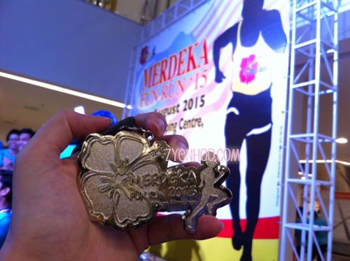 The medal for the Merdeka Fun Run! (You can just about make out the tiny inscription of 10km Finisher at the bottom)
