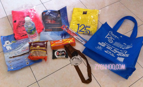 What's in our goodie bag.... the pink shirt is the running tee while the yellow shirt is the finisher tee. I collected my race pack from Adiah after the run, that's why the pink shirt is unworn.