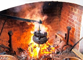 Heating the molasses in an iron pot until it just catches fire, at which point it needs quickly dousing